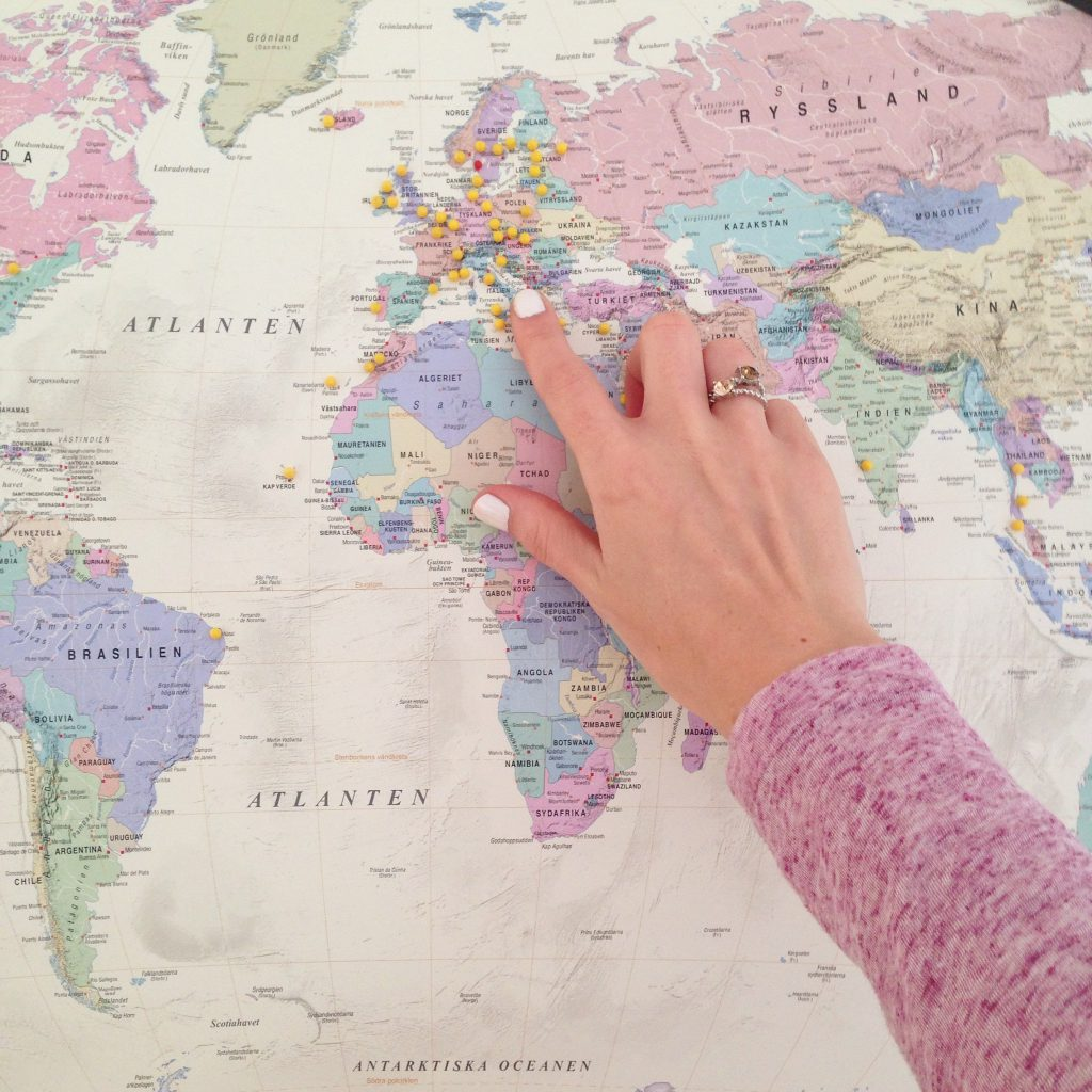 pointing at map of world pastel colour