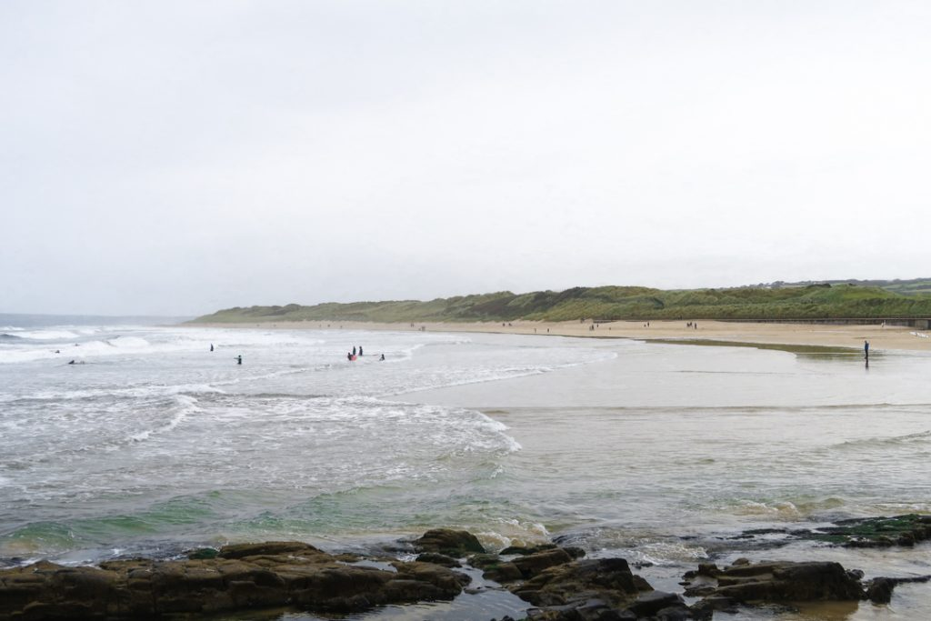 Brave surfers defying the cold September water, Portrush East Strand
